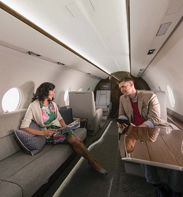Man and Woman talking inside private aircraft