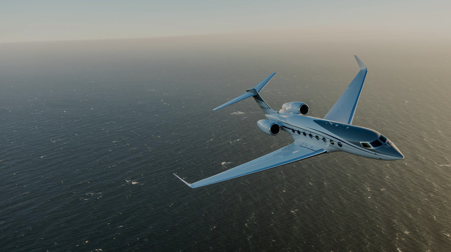G650ER flying over the ocean towards viewer