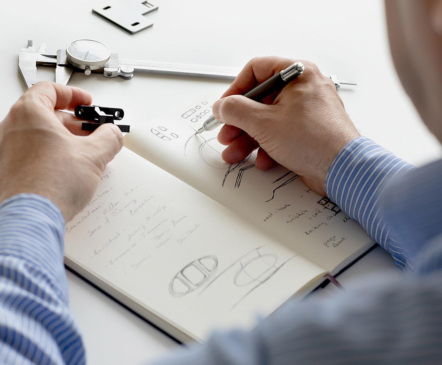 Artist sketches in a notebook